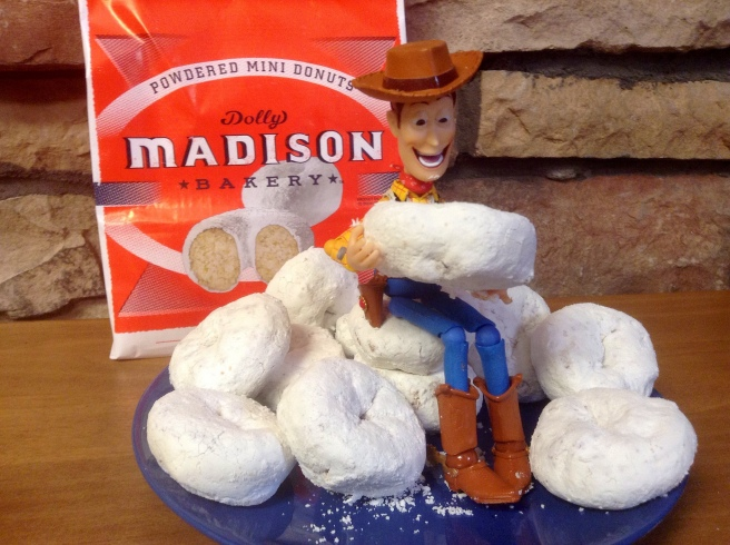 Woody on top of a pile of powdered donuts