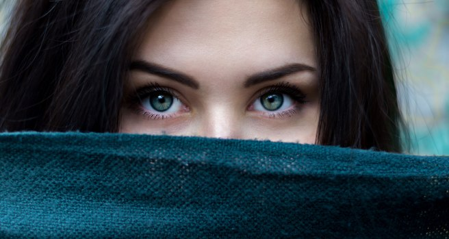 A woman with green eyes and false eylashes