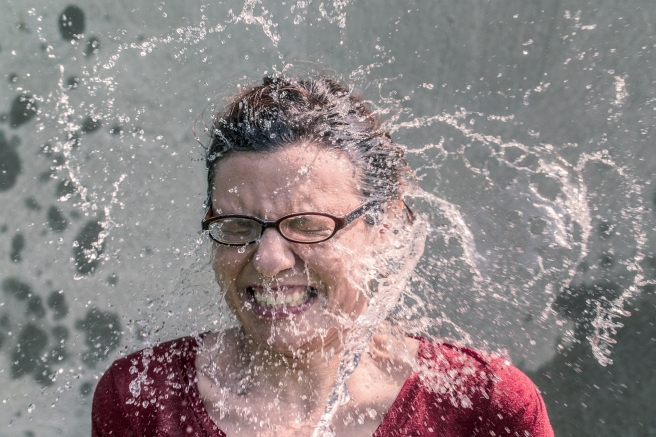 A woman splashed with cold water