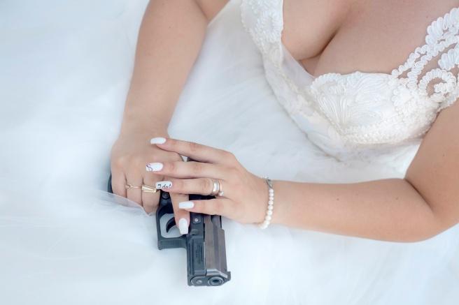 Bride holding a gun