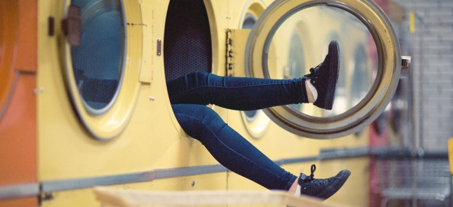 Girl in a dryer at a laundomat